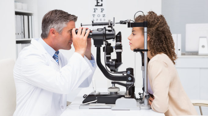 woman doing eye test with optometrist